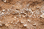 Cross section of soil. Soft focus. Potomje village, Dingac wine region, Peljesac peninsula. Dingac village and region. Peljesac peninsula. Dalmatian Coast, Croatia, Europe.