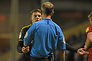 AFC Wimbledon defender Steve Seddon (15) argues with the referee during the EFL Sky Bet League 1 match between Walsall and AFC Wimbledon at the Banks's Stadium, Walsall, England on 12 February 2019.