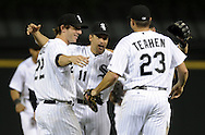 CHICAGO - JUNE 07:  Omar Vizquel #11, Brent Morel #22 and Mark Teahen #23 of the Chicago White Sox celebrate after the game against the Seattle Mariners on June 7, 2011 at U.S. Cellular Field in Chicago, Illinois.  The White Sox defeated the Mariners 5-1.  (Photo by Ron Vesely)  Subject:  Omar Vizquel;Brent Morel;Mark Teahen