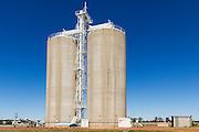 Grain silos rail transport depot in Wallumbilla in rural country Queensland, Australia. <br /> <br /> Editions:- Open Edition Print / Stock Image