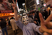 Young Japanese men wearing traditional Tengu masks enjoy Halloween celebrations in Shibuya. Saturday October 28th 2017