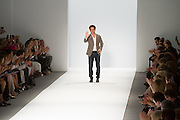 Designer Carolos Miele greets the crowd at the end of his Spring 2013 Fashion Week show in New York.