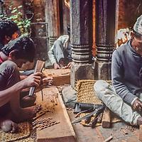 Artisans carve wood for an intricate door in Kathmandu, Nepal, 1986.