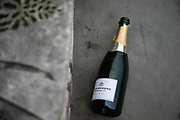 A bottle of Champagne lies discarded on 5th of November 2020, City of London, United Kingdom. It is the first day of national lockdown and many people met up to party the night before.