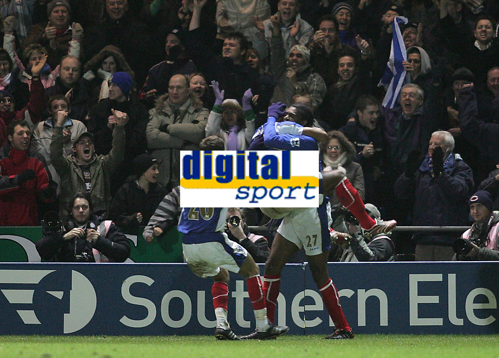 Photo: Lee Earle.<br /> Portsmouth v Manchester City. The Barclays Premiership. 10/02/2007.Kanu (R) is congratulated after scoring the winning goal.