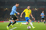 Uruguay midfielder Matías Vecino (15) and Brazil midfielder Renato Augusto (8) during the Friendly International match between Brazil and Uruguay at the Emirates Stadium, London, England on 16 November 2018.