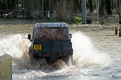 ©Licensed to London News Pictures 18/02/2020<br /> Yalding, UK. A 4x4 jeep speeding in flood water.  Flood warnings remain in place across the UK with more bad weather and rain expected. The village of Yalding in Kent has been flooded for the second time in 60 days. The area was flooded a few days before Christmas last year. Photo credit: Grant Falvey/LNP