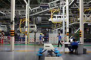 Workers operate on the assembly line at the SAIC GM Wuling Automobile Co., Ltd factory in Liuzhou, Guangxi Province, China, on August 24, 2009.   The Wuling minivan, popular amongst rural folks and a product of joint venture between General Motors, Shanghai Automotive Industry Corporation, and Liuzhou Wuling Auto, is China's best selling vehicle with over one million sold in 2008.