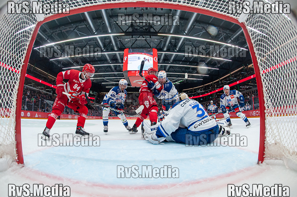 LAUSANNE, SWITZERLAND - OCTOBER 01: Tim Bozon #94 of Lausanne HC tries to score against Goalie Lukas Flueler #30 of ZSC Lions during the Swiss National League game between Lausanne HC and ZSC Lions at Vaudoise Arena on October 1, 2021 in Lausanne, Switzerland. (Photo by Monika Majer/RvS.Media)