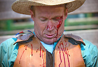 """Mark Wilson waits to be examed by Jackson Hole Fire/EMS after being tossed from a bronc while riding in the bareback event at the Jackson Hole Rodeo. Wilson had no other injuries other than the cut above his eye. """"I don't know if it'll make me look any worse,"""" Wilson said. """"I was pretty beat up already."""""""
