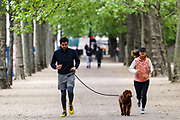 People are seen running with their animals and family members near St James' Park in London, Britain, on Sunday, May 3, 2020. Britons are now in their sixth week of lockdown due to the Coronavirus pandemic. Countries around the world are taking increased measures to stem the widespread of the SARS-CoV-2 coronavirus which causes the Covid-19 disease. (Photo/ Vudi Xhymshiti)