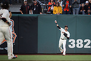 San Francisco Giants left fielder Gorkys Hernandez (66) catches a fly ball against the Pittsburgh Pirates at AT&T Park in San Francisco, California, on July 25, 2017. (Stan Olszewski/Special to S.F. Examiner)