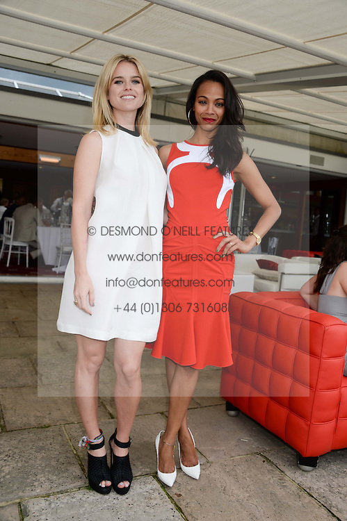 Left to right, ALICE EVE and ZOE SALDANA at the Audi International Polo at Guards Polo Windsor Great Park, Egham, Surrey on 28th July 2013.