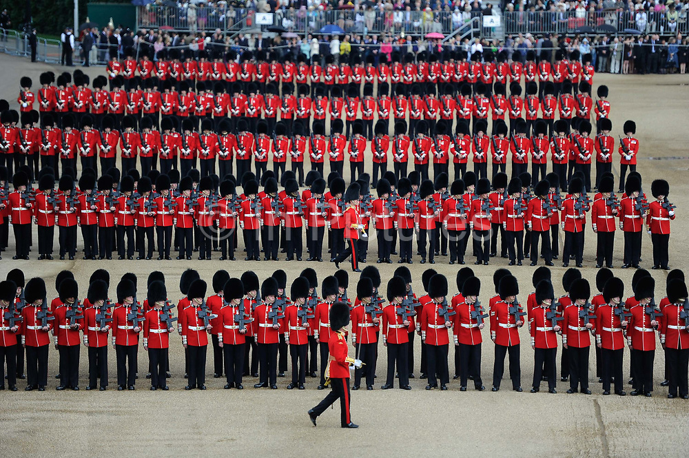 Soldiers of the British Army marching during Trooping the Colour on Horse Guards Parade in London, United Kingdom. The ceremonial event, which marks Queen Elizabeth IIs official birthday. This June event, part of the British Season of events has all the pomp and ceremony of massed bands, marching Guards in red tunics.