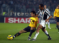 Photo: Chris Ratcliffe.<br /> Juventus v Arsenal. UEFA Champions League. Quarter-Finals. 05/04/2006. <br /> Cesc Fabregas clips the ball away from Emerson of Juventus