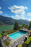 terrace with swimming pool of a nice house overlooking the lake