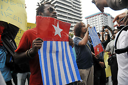 April 3, 2017 - Jakarta, Jakarta, Indonesia - An Activist carrying banners and pictures of the 'Bintang Kejora' flag helds by West Papuan activists, during a demonstration representatives of the United Nations office in Jakarta, Indonesia, 3 Apr 2017. Dozens of West Papuan activists held a rally demanding the right to determine self-determination for West Papua. (Credit Image: © Dasril Roszandi/NurPhoto via ZUMA Press)