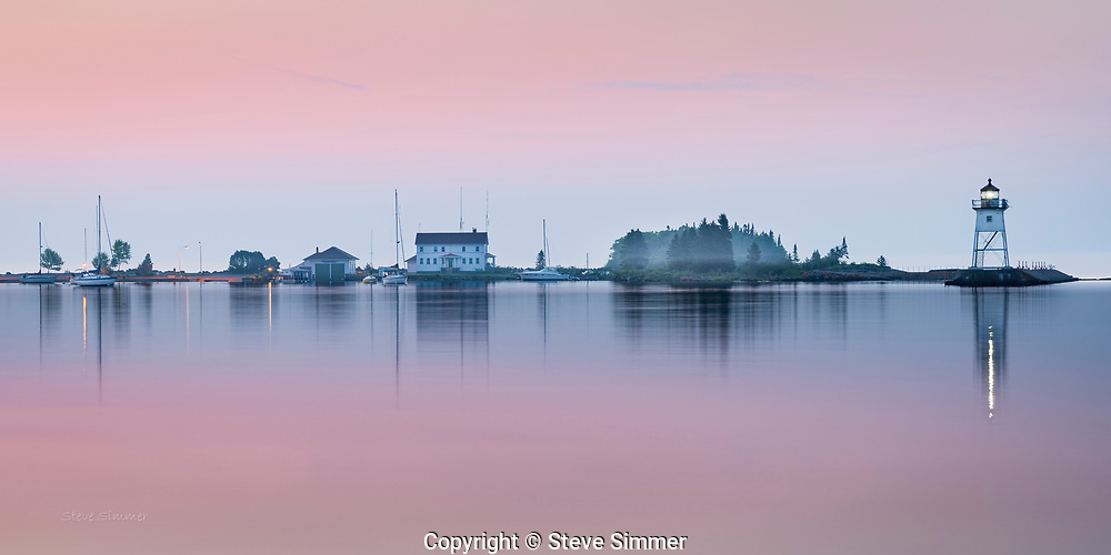 Perfectly still, a little light fog, and a half hour before the sun rises. These pastel colors are typical of the Lake Superior palette.