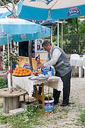 Turkey, Antalya, a Turkish man squeezing orange juice