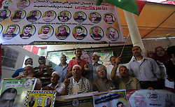 August 28, 2017 - Gaza City, Gaza Strip, Palestinian Territory - Palestinians take part in a protest to show solidarity with Palestinian prisoners held in Israeli jails, in front of Red cross office in Gaza city on August 28, 2017  (Credit Image: © Mohammed Asad/APA Images via ZUMA Wire)