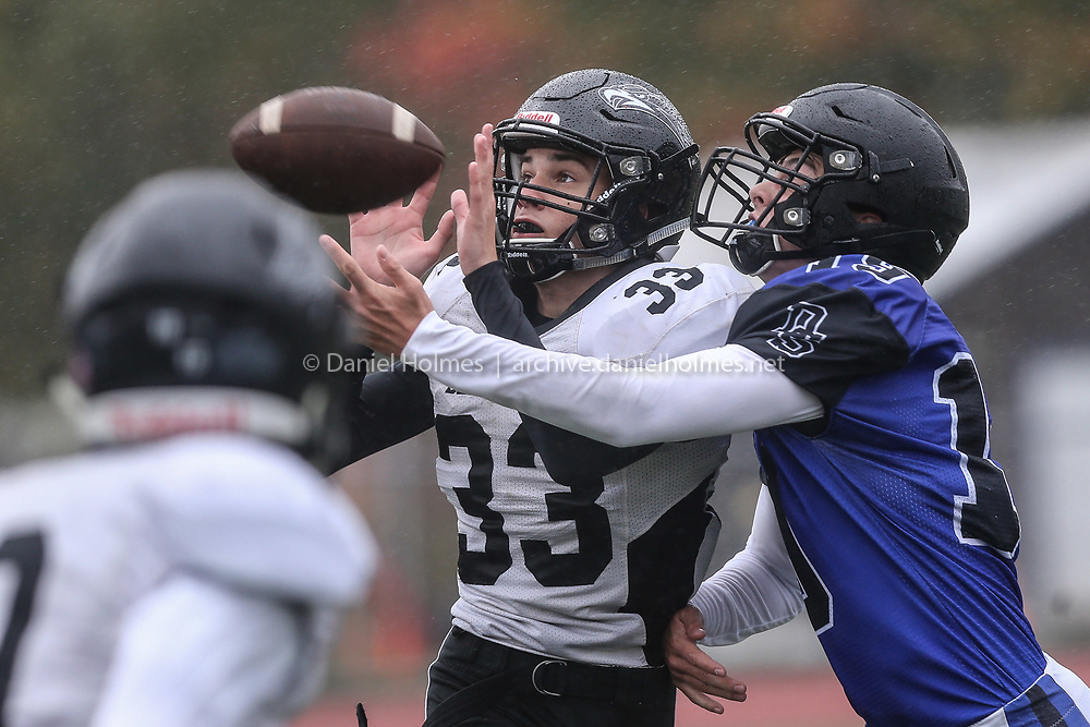 (10/11/19, DOVER, MA) Bellingham's Calvin Polpocheck breaks up the pass to Dover-Sherborn's Grady Russo  during the Tri-Valley League matchup at Dover-Sherborn High School on Friday. [Daily News and Wicked Local Photo/Dan Holmes]