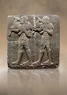 Photo of Hittite monumental relief sculpted orthostat stone panel of a Procession Basalt, Karkamıs, (Kargamıs), Carchemish (Karkemish), 900-700 B.C.  Anatolian Civilisations Museum, Ankara, Turkey. Young male servants of Kubaba while carrying sacrificial animals on their shoulders. <br /> <br /> Against a brown art background. .<br />  <br /> If you prefer to buy from our ALAMY STOCK LIBRARY page at https://www.alamy.com/portfolio/paul-williams-funkystock/hittite-art-antiquities.html  - Type  Karkamıs in LOWER SEARCH WITHIN GALLERY box. Refine search by adding background colour, place, museum etc.<br /> <br /> Visit our HITTITE PHOTO COLLECTIONS for more photos to download or buy as wall art prints https://funkystock.photoshelter.com/gallery-collection/The-Hittites-Art-Artefacts-Antiquities-Historic-Sites-Pictures-Images-of/C0000NUBSMhSc3Oo