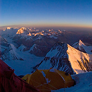 Sunrise lights up the crest of the Great Himalaya from Camp VI (27,300 feet) on Everest's Northeast Ridge route. In the distance the peaks of Gyachung Kang (7995m) and Cho Oyu (8201m) rise into the sunlight.
