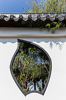 Decorative Chinese Window at Chao Pu-Ya Chinese Spirit Shrine -adjacent to the Thai-Chinese Cultural Centre; together they form the focal point of  Chaloem Phrakiat Park.  The shrine is a large Chinese spirit shrine with a Chinese rock garden that overlooks the lake. Two Chinese pavilions stand in the lake, serving as a view point in cool, breezy and shady surroundings. The golden dragon, used during the Thung Si Mueang annual festival in December, is kept here.  Most visitors assume that Chao Pu-Ya is a part of the Thai-Chinese Cultural Cener as they are across the street from each other.