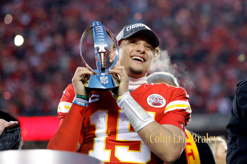 Kansas City Chiefs quarterback Patrick Mahomes holds the Lamar Hunt Trophy as he celebrates winning a NFL, AFC Championship football game against the Tennessee Titans, Sunday, Jan. 19, 2020, in Kansas City, MO. The Chiefs won 35-24 to advance to Super Bowl 54. Photo by Colin E. Braley Colin Eric Braley Photography