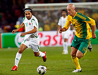 Hawar Mulla Mohammed of Iraq Matthew Booth of South Africa FIFA Confederations Cup South Africa 2009  South Africa  v Iraq at Coca Cola Park ( Ellis Park )  Stadium <br /> 14/06/2009 Credit Colorsport / Kieran Galvin