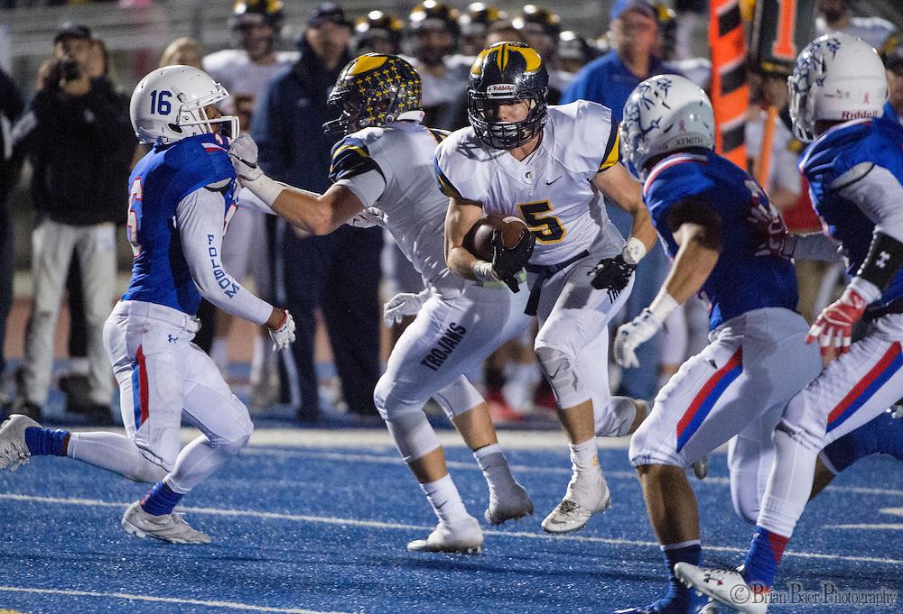 Oak Ridge Trojans Michael Pittman (5), runs with the ball during the first quarter as the Folsom High School Bulldogs varsity football team host the Oak Ridge High School Trojans,  Friday Nov 4, 2016.<br /> photo by Brian Baer