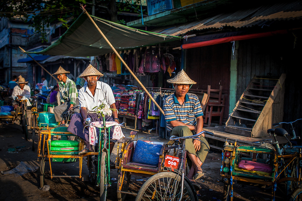 Rickshaw Drivers awate fares early in the morning near the Sittwe fish market.