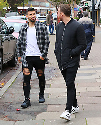 Manchester City's Sergio Aguero leaves Piccolino Restaurant in Hale Village, Cheshire on Thursday afternoon wearing a shredded pair of black jeans