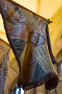 Regimental flags hanging in Salisbury Cathedral in Wiltshire, England