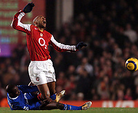 Photo: Javier Garcia/Back Page Images<br />Arsenal v Chelsea, FA Barclays Premiership, Highbury 12/12/04<br />Thierry Henry feels the force of a Claude Makelele challenge