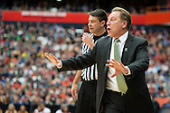 29 MAR 2015: Coach Tom Izzo of Michigan State University instructs his team as they take on University of Louisville during the 2015 NCAA Men's Basketball Tournament held at the Carrier Dome in Syracuse, NY. Michigan State defeated Louisville 76-70 to advance. Brett Wilhelm/NCAA Photos