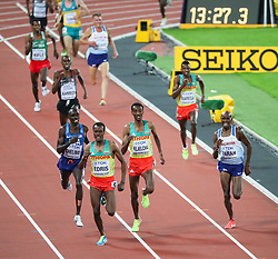 London, August 12 2017 . Muktar Edris, Ethiopia, sprints to glory ahead of Mo Farah, Great Britain, and Paul Kipkemoi Chelimo, USA, in the men's 5000m final on day nine of the IAAF London 2017 world Championships at the London Stadium. © Paul Davey.