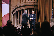 Mike Huckabee takes the stage after being introduced by James Robinson, president of LIFE Outreach International, during day two of the Conservative Political Action Conference (CPAC) at the Gaylord National Resort & Convention Center in National Harbor, Md.