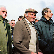 Spectators by the betting kiosks at the Tiverton Staghounds point-to-point steeplechases at Bratton Down, Barnstaple, Devon, UK. Fundraiser for the Devon and Somerset Staghounds.
