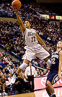 HARTFORD, CT - 22 FEBRUARY 2009 -022209JT08-.As UConn Coach Geno Auriemma watches, below, UConn's Maya Moore makes a layup past Notre Dame's Becca Bruszewski in the second half of Sunday's game at the XL Center in Hartford. Moore scored 18 points in the game. UConn won, 76-66..Josalee Thrift Republican-American
