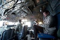 30 NOV 2010, JAGEL/GERMANY:<br /> Karl-Theodor zu Guttenberg, CSU, Bundesverteidigungsminister, liest im Cockpit in seinen Unterlagen, waehrend dem Flug mit einer Transall vom Fliegerhorst Jagel nach Berlin, nach der  Rueckkehr der in Afghanistan eingesetzten RECCE TORNADO Aufklaerungsjets<br /> IMAGE: 20101130-01-072<br /> KEYWORDS: Bundeswehr, Armee, Luftwaffe, lesen