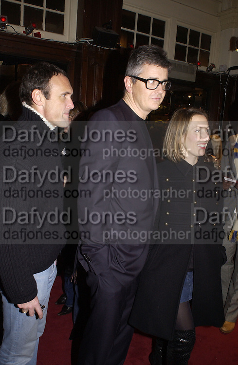 A.A.Gill, Jay Jopling and Sam Taylor Wood. M.A.C. Aids fund benefit concert given by Elton John. Shepherds Bush Empire. 16 December 2002.<br />