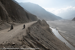 Riding along the Kali Gandaki River on day-5  of our Himalayan Heroes adventure riding from Kalopani through the Mustang District to our highest elevation of the trip at over 12,000' when we reached Muktinath, Nepal. Saturday, November 10, 2018. Photography ©2018 Michael Lichter.