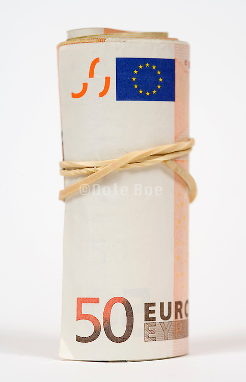 stack of 50 Euro bills in a roll with a rubber band around it