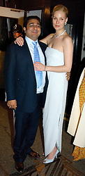 The HON.ANGAD PAUL and his bride MICHELLE BONN leaving a reception to celebrate the wedding of Lord Paul's youngest son Angad to Michelle Bonn held at Lancaster House, London on 21st March 2005.<br /><br />NON EXCLUSIVE - WORLD RIGHTS