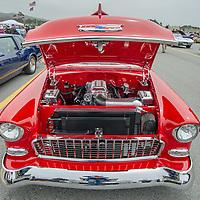 Visitors admire antique cars at Dream Machines, Half Moon Bay Airport, California.
