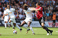 Tammy Abraham of Swansea city holds off Nemanja Matic of Manchester Utd ®.  Premier league match, Swansea city v Manchester Utd at the Liberty Stadium in Swansea, South Wales on Saturday 19th August 2017.<br /> pic by  Andrew Orchard, Andrew Orchard sports photography.
