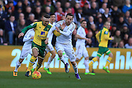 Gylfi Sigurdsson of Swansea city breaks away from Gary O''Neil (L) of Norwich city. Barclays Premier league match, Swansea city v Norwich city at the Liberty Stadium in Swansea, South Wales  on Saturday 5th March 2016.<br /> pic by  Andrew Orchard, Andrew Orchard sports photography.