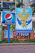Contradictory billboards of a pepsi logo and communist propaganda in Ho Chi Minh City, Vietnam, Southeast Asia