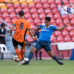 BRISBANE, AUSTRALIA - MARCH 25: Adam Sawyer of the Roar and Mustafa Jafari of SWQ Thunder compete for the ball during the round 5 NPL Queensland match between the Brisbane Roar and SWQ Thunder at Suncorp Stadium on March 25, 2017 in Brisbane, Australia. (Photo by Patrick Kearney/Brisbane Roar)
